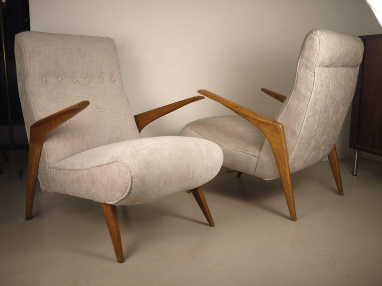 A pair of midcentury Italian armchairs. Teak structure and Italian fabric. Excellent condition. Very comfortable.
