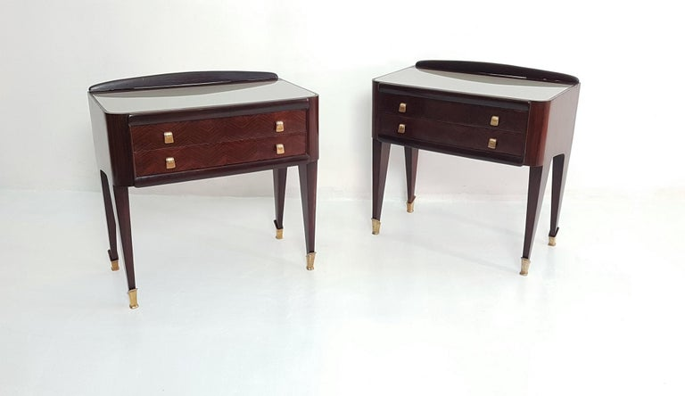 These two side tables or nightstands are both refined and elegant in every way. The glass tops has a platinum color which contrasts beautifully to the rosewood inlayed zigzag pattern of the two drawers. These sculptural Italian tables are elegant