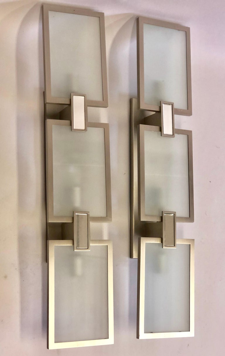 Pair of Italian style Mid-Century Modern style nickel, mirror and frosted glass sconces.