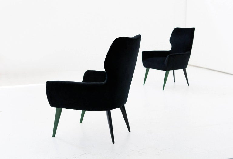 Pair of easy armchairs manufactured in Italy in the 1950s  New padding and new upholstery with black cotton velvet. Mahogany black and green lacquered legs, you can request a different front legs color.