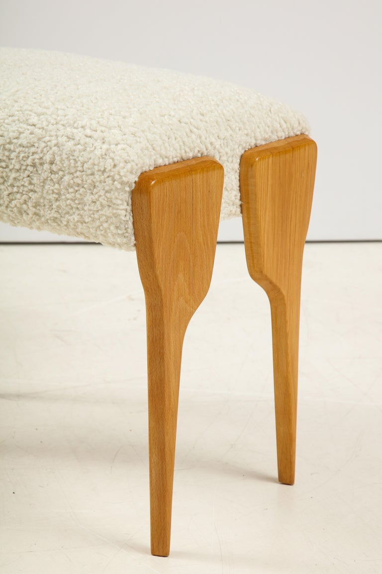 A wonderful pair of Italian 1950's beechwood stools. The angular shaped legs create a fantastical and elegant effect. The seats newly upholstered in creamy textured Kravet fabric. Perfect for any room in the house.  Italy, circa 1950  Size: 18