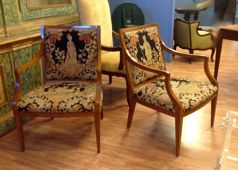 Fine fruitwood frames and dramatic original needlepoint seats and backrests.