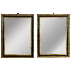 Pair of Italian Neoclassic Ebonized and Giltwood Mirrors