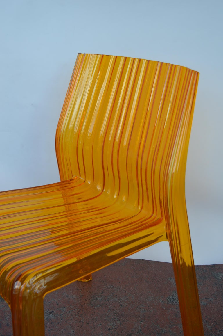 20th Century Pair of Italian Orange Chairs by Kartell For Sale