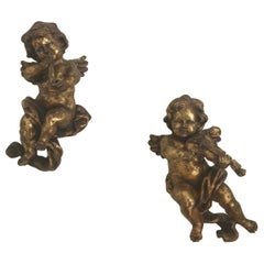 Pair of Italian Putti Playing Musical Instruments