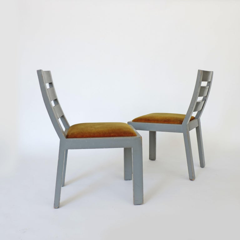 Pair of Italian rationalist movement chairs, Italy, 1930s Light grey paint and yellow velvet.