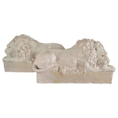Pair of Italian Reclining Glazed Terracotta Lions