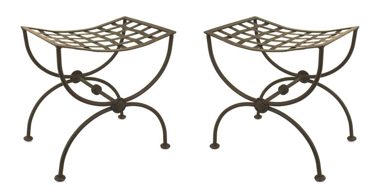 Pair of Italian Renaissance style (1940s) black painted wrought iron benches with cross form