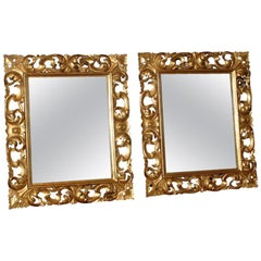 Pair of Italian Roccoco Style Gilt and Carved Wood Mirrors, Late 19th Century
