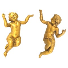 Pair of Italian Rococo Style Large Hanging Cupid Figures