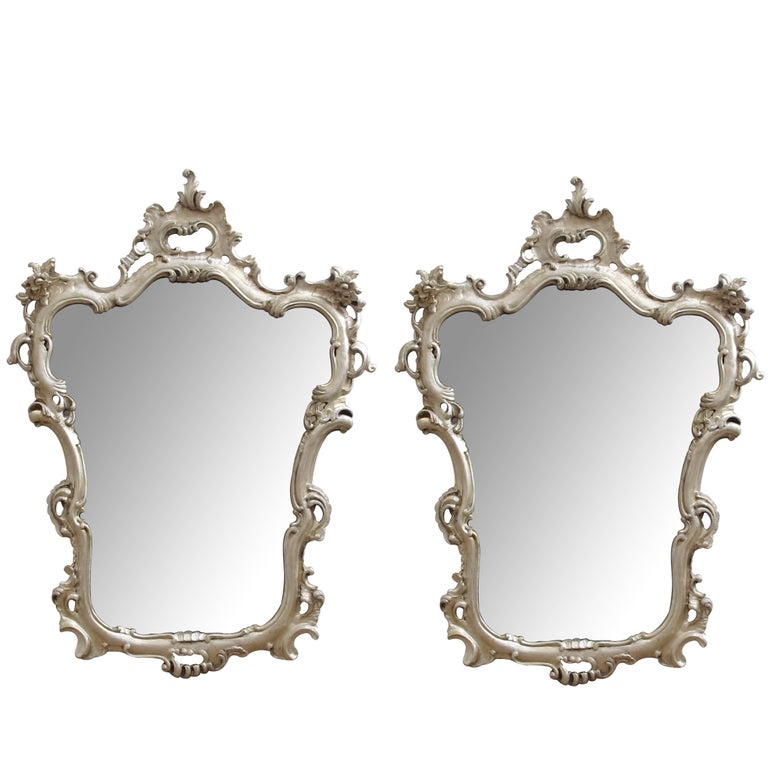 Pair of Italian Rococo Style Silver-Leafed Giltwood Cartouche-Form Mirrors