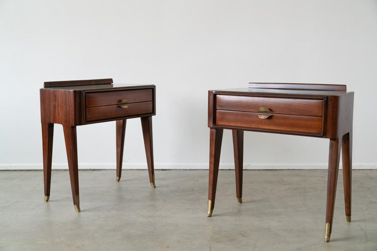 Gorgeous pair of Italian nightstands in the style of Gio Ponte.  Original opaque glass, great patina to brass hardware and angled legs.  Beautifully refinished in French Polish finish.
