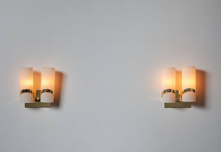 Pair of sconces designed in Italy, circa 1960s. Brass and brushed satin glass. Wired for US junction boxes. Each light takes one E27 100w maximum bulb. Brass has been fully restored and polished.