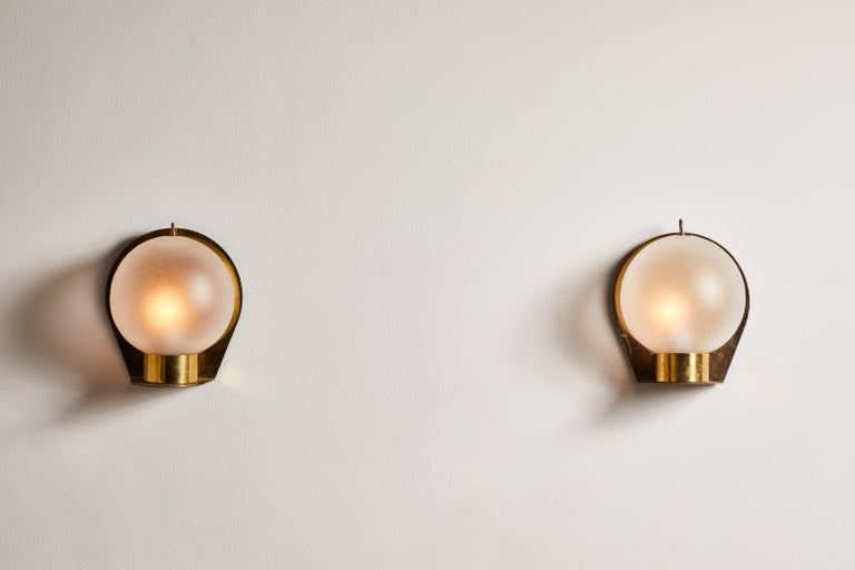 Pair of sconces manufactured in Italy, circa 1950s. Opaline glass, brass. Rewired for U.S. junction boxes. Each light takes one E27 50w maximum bulb. Bulbs provided as a one time courtesy.