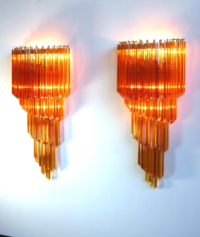 Huge and fantastic pair of vintage Murano wall sconce made by 41 Murano crystal prism (quadriedri) for each applique in a chrome metal frame. The shape of this sconce is spiral. The glasses are amber color. Period: 1980s Dimensions: 31.50 inches