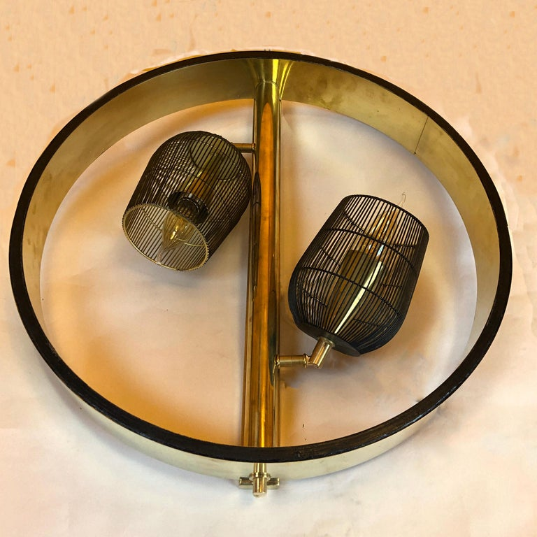 Pair of Italian Space Age round brass sconces with adjustable black iron lampshades. 2 light bulbs E14 each.