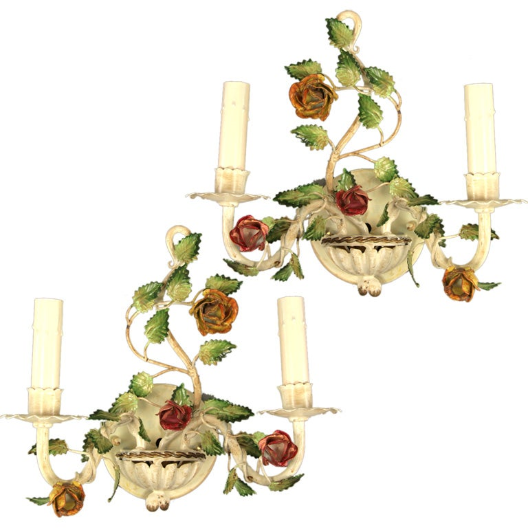 #2-501, pair of hand painted two-light tole sconces. Takes 60 watt max candelabra base bulb.