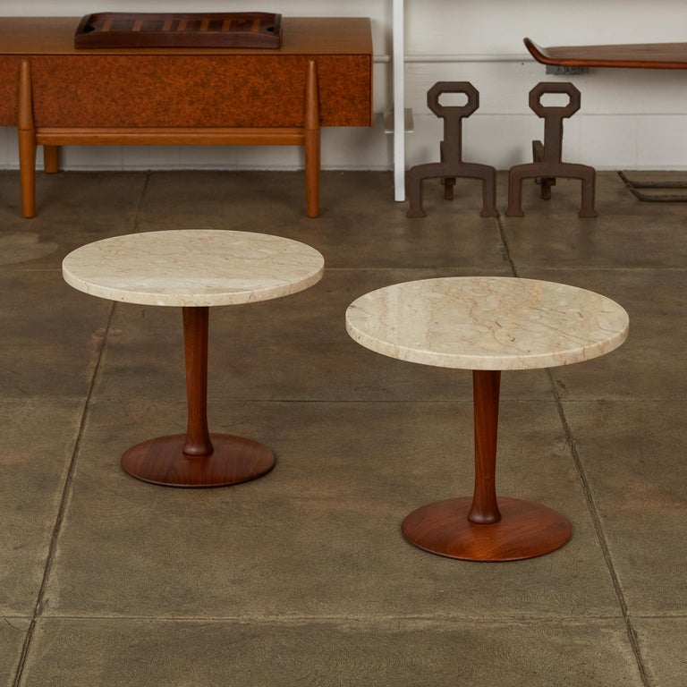 """Pair of Italian marble side table with turned walnut base. This pedestal end tables feature polished circular cream travertine tops with turned walnut stem and rounded flat bases. Stone is marked """"Italy"""" on the underside.   Dimensions: 18"""" diameter"""