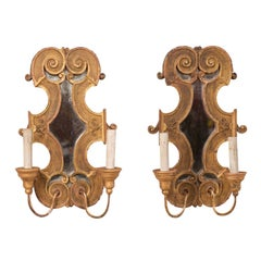 Pair of Italian Two-Light Sconces of Scrolled Giltwood with Mirrored Back-Plate