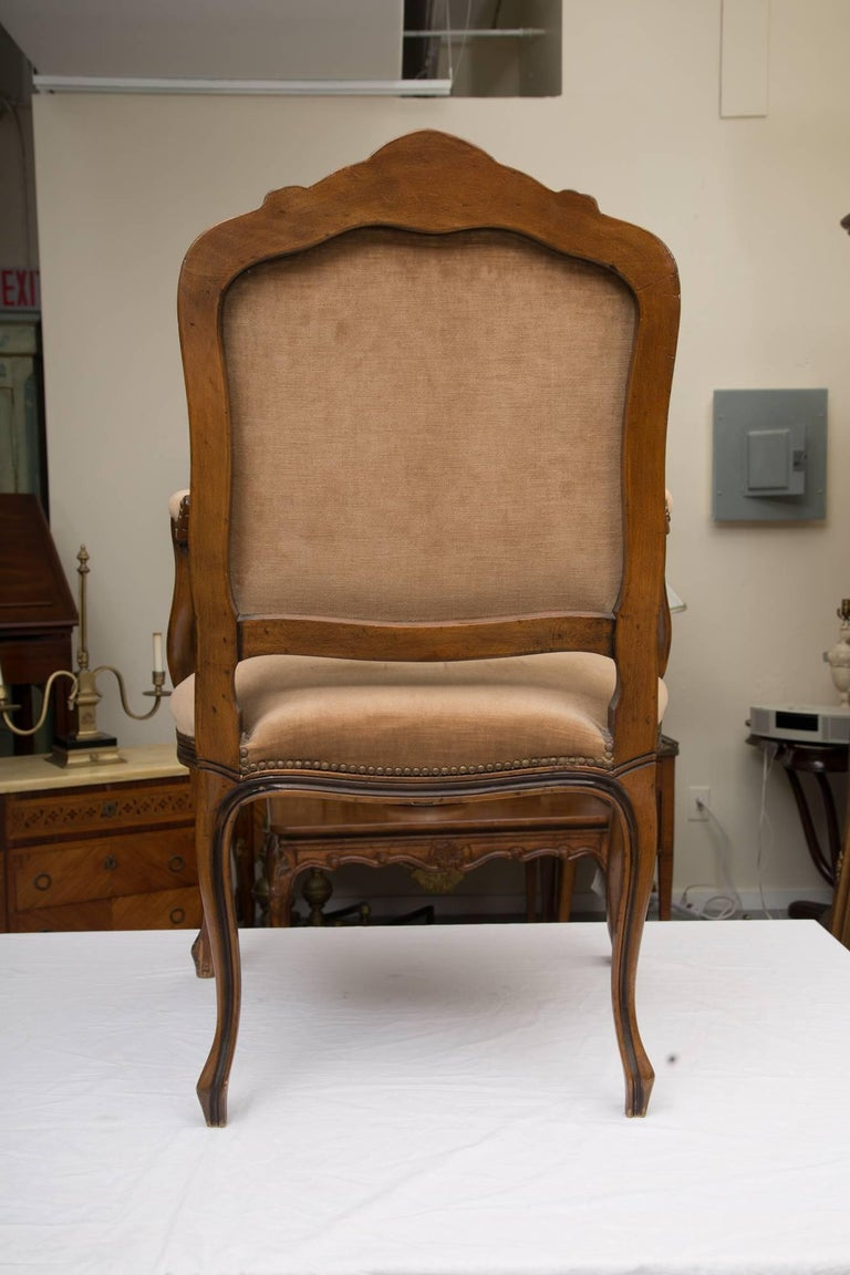 These chairs are hand-carved and upholstered in a soft neutral fabric. Although the chairs are 20th century they are modeled after the design of the period.