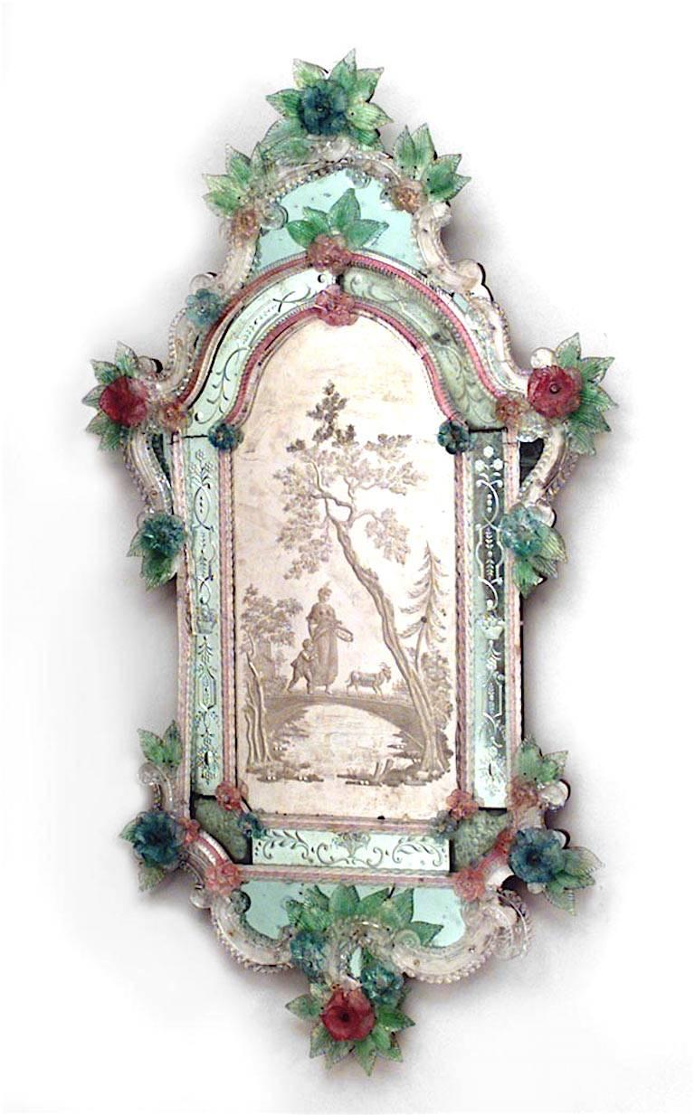 Pair of Italian Venetian Murano (19th century) vertical wall mirrors with etched scene of figures in landscape and trimmed with floral colored glass flowers.