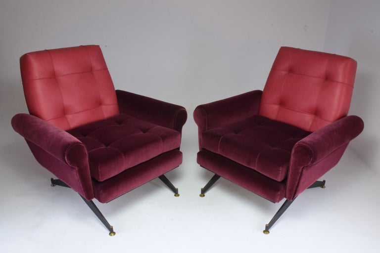 Pair of Italian 20th century vintage armchairs circa 1950s with steel compass legs, comfortable depth, in fully restored condition: re-upholstered in a high quality Lelièvre Paris red velvet and Italian leather backrest with new foam