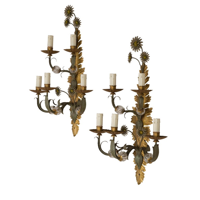 A very decorative pair of Italian, 1970s painted iron and glass 5-branch wall sconces.