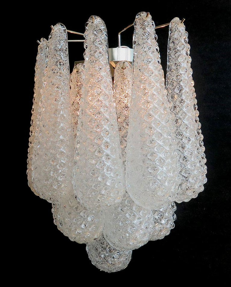 Fantastic pair of vintage Murano wall sconce made by 10 glass petals (transparent crystal, smooth outside, with crystal powder and then rough inside) in a chrome frame. Period: 1970s Dimensions: 17.70 inches height (45 cm); 13.40 inches width (34