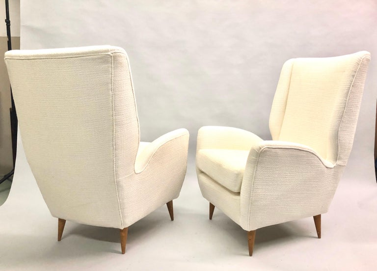 Elegant pair of Italian Mid-Century Modern hi-back lounge chairs / armchairs, model #512 by Gio Ponti. Recently re-upholstered in Italy of Italian cotton.  Documentation: See Gio Ponti by Ugo La Pietra, Rizzoli, New York.   References: Hotel