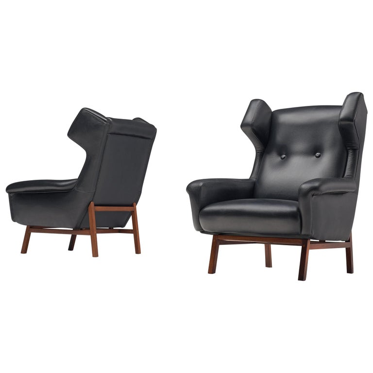 Pair of Italian Wingback Lounge Chairs in Black Leather For Sale