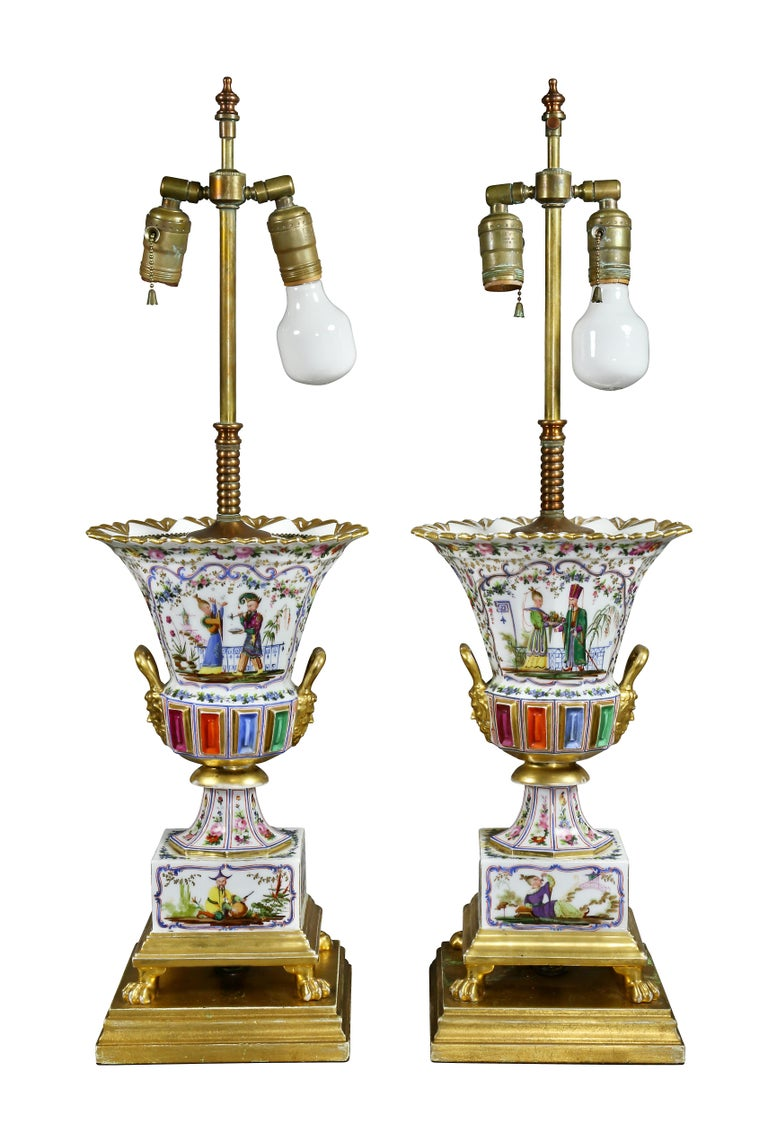 Each with figures and floral decoration with jeweled midsection with gilt masks, square base with paw feet.