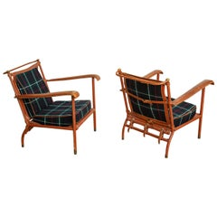 Pair of Jacques Adnet Lounge Chairs
