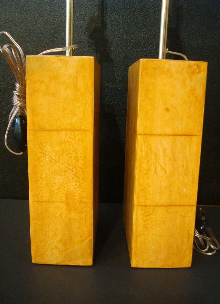 Art Deco Lovely pair of parchment leather table lamps. Jacques Adnet. Made in France, circa 1930s. Have been rewired. And the leather has been re-polished.