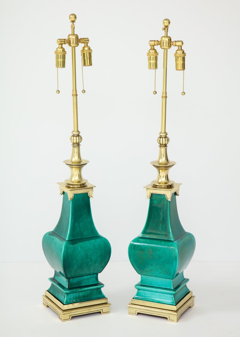 Pair of ceramic lamps with a beautiful Jade Green crackle glazed finish by Stiffel. The lamps are mounted on polished brass bases and they have been Newly rewired with brass double clusters.
