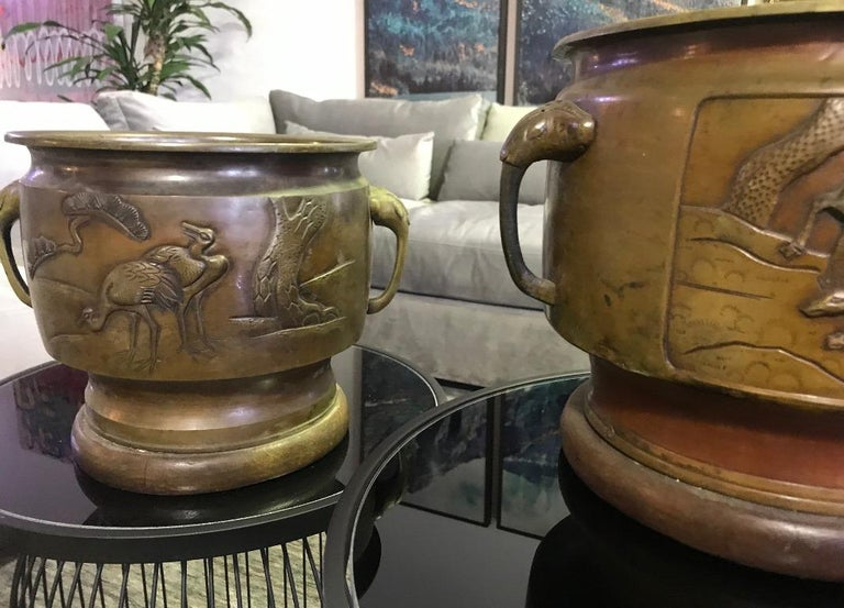 A gorgeous set of bronze Japanese planters with dear, crane and forest motifs.  Likely from Showa Period but possibly Meiji Period.  From a collection of Japanese art and artifacts.  Would be a great addition to any collection. Sure to stand