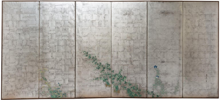 """A pair of six-panel screen with a silver ground, decorated with the """"Seven kinds of grass of Autumn"""" ("""