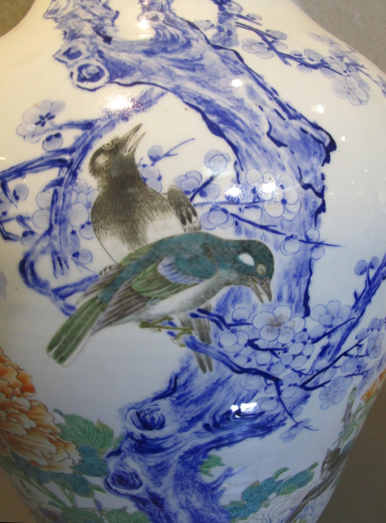 Japanese very large Meiji Fukagawa/Koransha signed porcelain Vases (circa 1880,) intricately hand-painted in cobalt blue underglaze, and green and red, on a stunningly shaped baluster body in pure white which is the characteristic of Imari-Arita