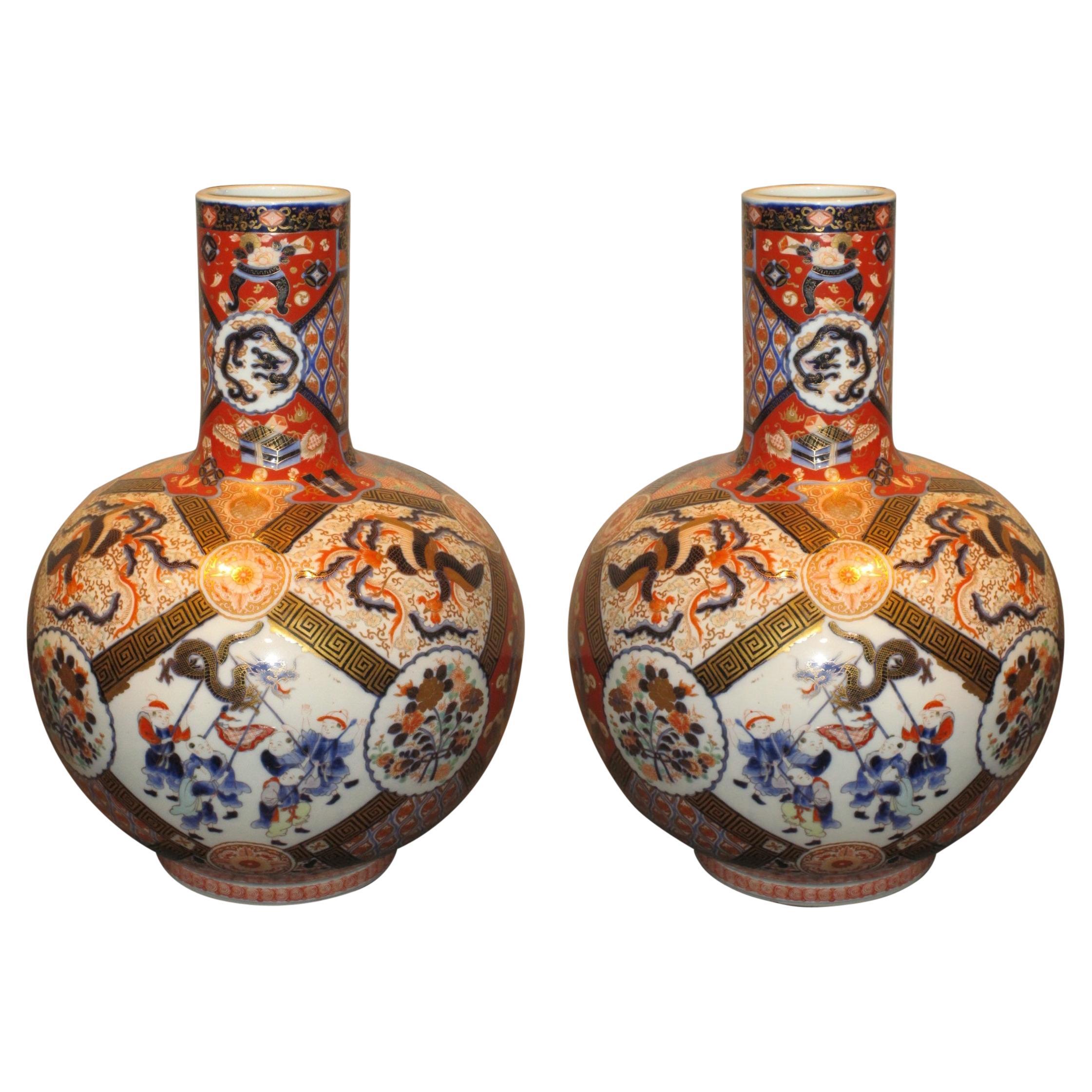 Pair of Japanese Meiji Fukagawa Blue Red Green Porcelain Vases, circa 1900