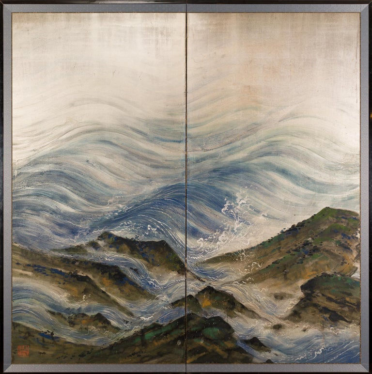 Japanese two panel screen: Rocky coastal landscape on silver, Meiji period (1868-1912) dramatic painting of ocean waves crashing on a rocky shoreline. Beautifully painted sea spray and textured rocks in mineral pigments on silver leaf. Pair
