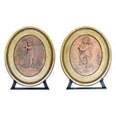 Pair of Jean Baptiste Vietty Oval Terracotta Bas Relief Cherub Plaques, Signed a