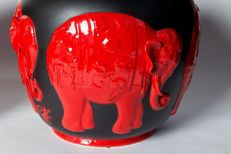 Pair of black and red ceramic elephant lidded ginger jars by Jean Boggio for Franz. Handmade and hand painted.