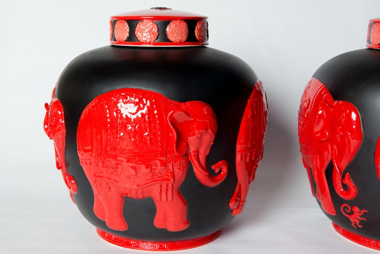 Central Asian Pair of Jean Boggio Coral Red and Black Elephant Lidded Ginger Jars For Sale
