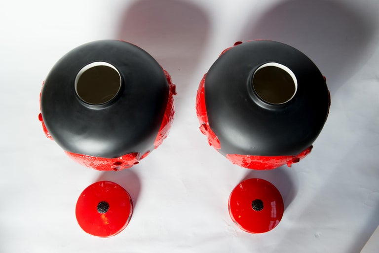 Ceramic Pair of Jean Boggio Coral Red and Black Elephant Lidded Ginger Jars For Sale