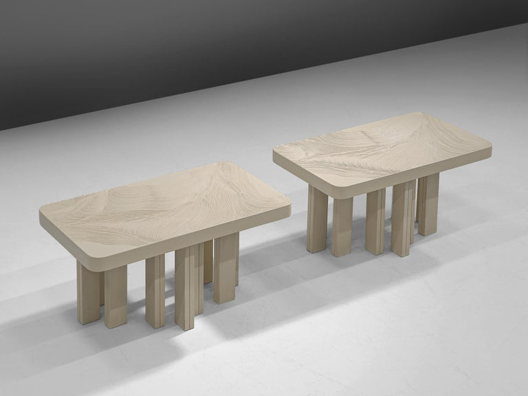 Jean Claude Dresse, pair of side tables, resin and steel, Belgium, 1970s  Elegant pair of coffee tables with a table top white resin, with an etched organic pattern visible in the top. The table top rests on a sturdy base executed in white lacquered