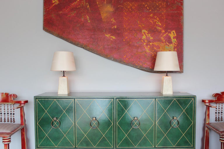 A pair of small scale faux plaster, resin table lamps in the style of Jean-Michel Frank. Very well made.