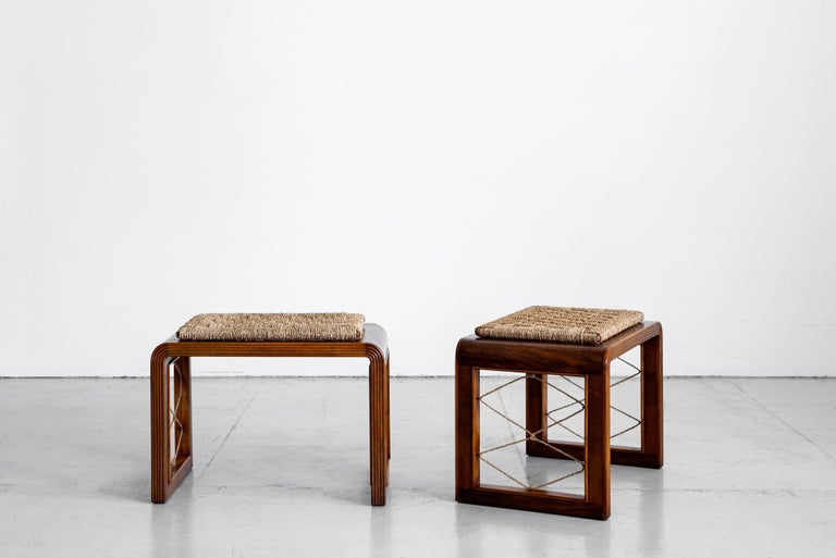 Fantastic pair of French bentwood stools in the style of Jean Royere. Curved wood frame with rushed seats and rope side