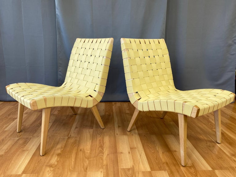 A pair of 2013 Jens Risom lounge chairs for KnollStudio in maple with maize webbing seats.
