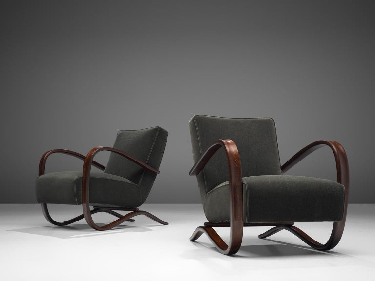 Jindrich Halabala, lounge chairs, mohair fabric and darkened wood, Czech-Republic, 1930s   These easy chairs are designed by Jindrich Halabala in the 1930s. The main feature of this chair by Hindrich Halabala are the voluptuous curved armrests,