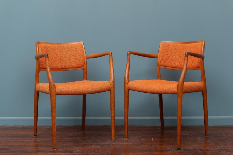 Pair of J.L. Moller teak armchairs, model 80 for Niels Moller Denmark. In very good original condition, signed.