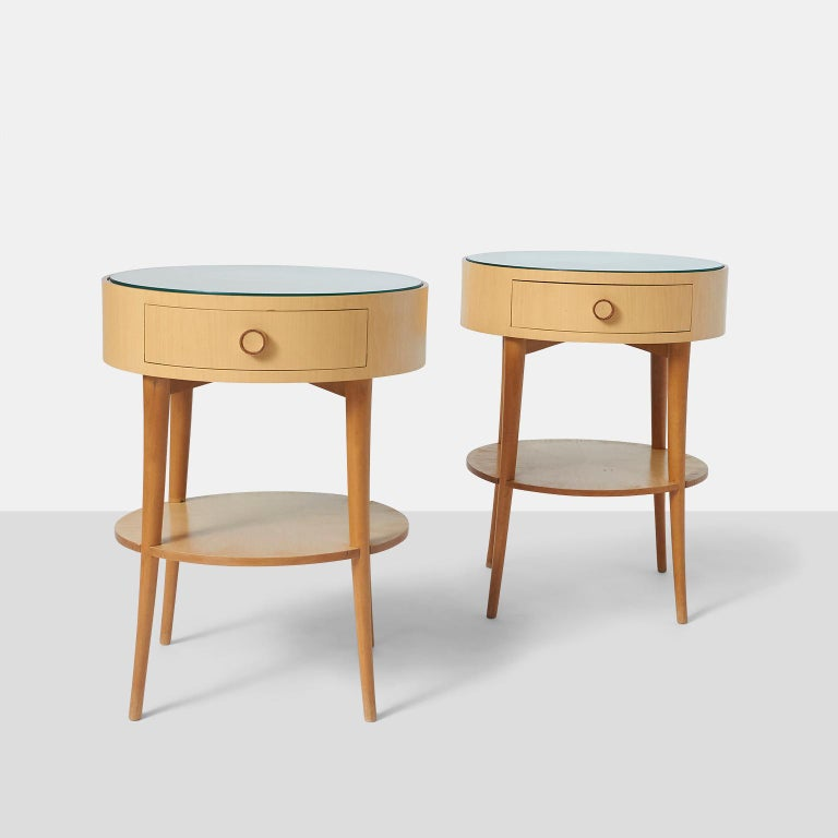 Pair of Joaquim Tenreiro side tables A pair of Joaquim Tenriero side tables in ivory wood with glass top. There is a lower single shelf and a single drawer at the top. Exceptionally rare and retains the original label. Brazil, circa 1950s.